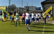 18 April 2015; Clonmel Celtic captain Craig Condon and Sheriff YC captain Paul Murphy lead their teams out for the start of the game.  FAI Aviva Junior Cup Semi-Final, Clonmel Celtic v Sheriff YC. Cooke Park, Tipperary Town, Co. Tipperary. Picture credit: Diarmuid Greene / SPORTSFILE