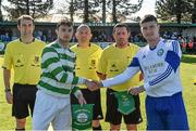 18 April 2015; Sheriff YC captain Paul Murphy and Clonmel Celtic captain Craig Condon exchange pendants and a handshake in the company of referee Gary Fitzgerald before the game.  FAI Aviva Junior Cup Semi-Final, Clonmel Celtic v Sheriff YC. Cooke Park, Tipperary Town, Co. Tipperary. Picture credit: Diarmuid Greene / SPORTSFILE