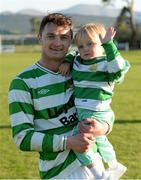 18 April 2015; Sheriff YC captain Paul Murphy celebrates with his 2-year-old son Jude Murphy after the game.  FAI Aviva Junior Cup Semi-Final, Clonmel Celtic v Sheriff YC. Cooke Park, Tipperary Town, Co. Tipperary. Picture credit: Diarmuid Greene / SPORTSFILE