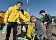 18 April 2015; Sheriff YC supporter Jake Byrne, aged 6, along with his mother Vanessa Byrne, gets some Aviva goodies before the game.  FAI Aviva Junior Cup Semi-Final, Clonmel Celtic v Sheriff YC. Cooke Park, Tipperary Town, Co. Tipperary. Picture credit: Diarmuid Greene / SPORTSFILE