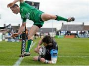 25 April 2015; Tommy Seymour, Glasgow Warriors, scores his side's fifth try dispite the tackle of John Cooney, Connacht. Guinness PRO12, Round 20, Connacht v Glasgow Warriors. Sportsground, Galway. Picture credit: Oliver McVeigh / SPORTSFILE