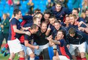 25 April 2015; The Clontarf team celebrate after the game. Men's Irish Hockey Trophy final, Bandon v Clontarf. Belfield, Dublin. Picture credit: Ray Lohan/SPORTSFILE