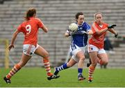 26 April 2015; Geraldine Sheridan, Cavan, in action against Caroline O'Hanlon, left, and Marian McGuinness, Armagh. TESCO HomeGrown Ladies National Football League, Division 2, Semi-Final, Armagh v Cavan. St Tiarnach's Park, Clones, Co. Monaghan. Picture credit: Pat Murphy / SPORTSFILE