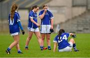 26 April 2015; Cavan players, from left, Catriona Smith, Aoibhin Kiernan, Laura Fitzpatrick and Geraldine Sheridan at the final whistle after defeat against Armagh. TESCO HomeGrown Ladies National Football League, Division 2, Semi-Final, Armagh v Cavan. St Tiarnach's Park, Clones, Co. Monaghan. Picture credit: Pat Murphy / SPORTSFILE