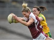 26 April 2015; Johanna Maher, Westmeath, in action against Nicole McLaughlin, Donegal. TESCO HomeGrown Ladies National Football League, Division 2, Semi-Final, Donegal v Westmeath. St Tiarnach's Park, Clones, Co. Monaghan. Picture credit: Pat Murphy / SPORTSFILE