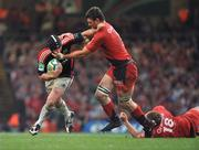 24 May 2008; Denis Leamy, Munster, is tackled by Fabien Pelous, Toulouse. Heineken Cup Final, Munster v Toulouse, Millennium Stadium, Cardiff, Wales. Picture credit: Brendan Moran / SPORTSFILE