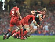 24 May 2008; Jerry Flannery, Munster, is tackled by Fabien Pelous, left, and Gregory Lamboley, Toulouse. Heineken Cup Final, Munster v Toulouse, Millennium Stadium, Cardiff, Wales. Picture credit: Brendan Moran / SPORTSFILE