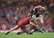 24 May 2008; Denis Leamy, Munster, is tackled by William Servat and Fabien Pelous, Toulouse. Heineken Cup Final, Munster v Toulouse, Millennium Stadium, Cardiff, Wales. Picture credit: Brendan Moran / SPORTSFILE