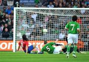 24 May 2008; Serbia's Marko Pantelic beats Richard Dunne and goalkeeper Dean Kiely to score his side's first goal. Friendly international, Republic of Ireland v Serbia. Croke Park, Dublin. Picture credit: David Maher / SPORTSFILE