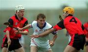 3 June 2000; Kevin Kennedy of New York in action against Down players, John Caughey, right, and Gary Gordan, during the Guinness Ulster Senior Hurling Championship Quarter-Final between Down and New York at Casement Park in Belfast. Photo by Ray McManus/Sportsfile