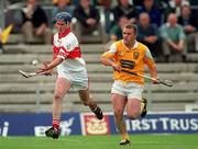 9 July 2000; Michael Collins of Derry in action against Ciaran McCambridge of Antrim during the Guinness Ulster Hurling Championship Final match between Derry and Antrim at Casement Park in Belfast. Photo By Aoife Rice/Sportsfile