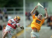 9 July 2000; Conor Cunning of Antrim in action against Michael Conway of Derry during the Guinness Ulster Hurling Championship Final match between Derry and Antrim at Casement Park in Belfast. Photo By Aoife Rice/Sportsfile