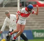 9 July 2000; Oliver Collins of Derry celebrates after scoring his side's third goal during the Guinness Ulster Hurling Championship Final match between Derry and Antrim at Casement Park in Belfast. Photo By Aoife Rice/Sportsfile