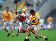 9 July 2000; Emmet O'Hara of Antrim in action against Michael Collins of Derry during the Guinness Ulster Hurling Championship Final match between Derry and Antrim at Casement Park in Belfast. Photo By Aoife Rice/Sportsfile
