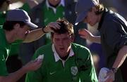 3 June 2000; Shane Horgan of Ireland receives treatment for a head wound from Irish Rugby Dr. Michael Griffin, and physiotherapist Denise Fanagan during the Rugby International match between Argentina and Ireland at Club Atletico Ferrocarril Oeste in Buenos Aires, Argentina. Photo by Matt Browne/Sportsfile