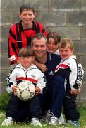 12 July 2000; Derek Swan pictured with childen, from left, Derek, aged 13, who plays soccer for Home Farm, Ryan, aged 4, Leah, aged 9, and Anthony, aged 3, during a feature photo shoot at their home in Johnstone Park, Dublin. Photo by Matt Browne/Sportsfile