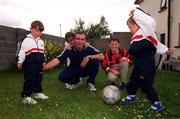 12 July 2000; Derek Swan pictured with his children playing soccer, from left, Ryan,  aged 4, Leah, aged 9, Derek, aged 13, who plays soccer for Home Farm, and Anthony, aged 3, during a feature photo shoot at their home in Johnstone Park, Dublin. Photo by Matt Browne/Sportsfile