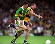 16 July 2000; Eamonn Fitzmaurice of Kerry in action against Martin Daly of Clare during the Bank of Ireland Munster Senior Football Championship Final between Kerry and Clare at the Gaelic Grounds in Limerick. Photo By Brendan Moran/Sportsfile