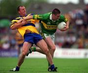 16 July 2000; Dara O'Se of Kerry in action against Martin Daly of Clare during the Bank of Ireland Munster Senior Football Championship Final between Kerry and Clare at the Gaelic Grounds in Limerick. Photo By Brendan Moran/Sportsfile