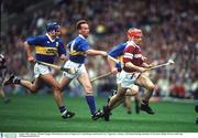 August 1993; Galway's Michael Hopper McGrath races clear of Tipperary's Conal Bonner and Declan Carr. Tipperary v Galway, All-Ireland Hurling semi-final, Croke Park, Dublin. Picture credit; Ray McManus/SPORTSFILE