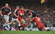 24 May 2008; Donncha O'Callaghan, Munster, is tackled by Fabien Pelous and Shaun Sowerby, 8, Toulouse. Heineken Cup Final, Munster v Toulouse, Millennium Stadium, Cardiff, Wales. Picture credit: Brendan Moran / SPORTSFILE