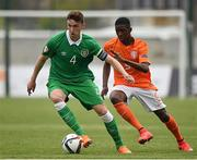 7 May 2015; Conor Masterson, Republic of Ireland, in action against Nigel Robertha, The Netherlands. UEFA European U17 Championship Finals Group D, Republic of Ireland v Netherlands. Sozopol Stadium, Sozopol, Bulgaria. Picture credit: Pat Murphy / SPORTSFILE