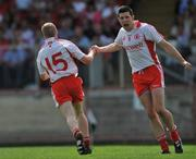 8 June 2008; Tyrone's Colm McCullagh, left, celebrates with team-mate Sean Cavanagh after scoring his side's first goal. GAA Football Ulster Senior Championship Quarter-Final, Tyrone v Down, Healy Park, Omagh, Co. Tyrone. Picture credit: Brian Lawless / SPORTSFILE
