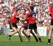 8 June 2008; Colm Cavanagh, Tyrone, in action against Daniel Hughes and Aidan Carr, Down. GAA Football Ulster Senior Championship Quarter-Final, Tyrone v Down, Healy Park, Omagh, Co. Tyrone. Picture credit: Oliver McVeigh / SPORTSFILE