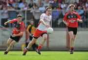 8 June 2008; Colm Cavanagh, Tyrone, in action against Colm Murney, left, and Jack Lynch, Down. GAA Football Ulster Senior Championship Quarter-Final, Tyrone v Down, Healy Park, Omagh, Co. Tyrone. Picture credit: Brian Lawless / SPORTSFILE
