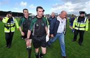 22 June 2008; Referee Eamonn Morris, 2nd from left, is confronted by Limerick manager Richie Bennis as he is escorted from the pitch by Gardai after the game. GAA Hurling Munster Senior Championship Semi-Final, Limerick v Clare, Semple Stadium, Thurles, Co. Tipperary. Picture credit: Brendan Moran / SPORTSFILE