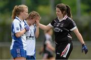 9 May 2015; Waterford's Hannah Landers, left, and Megan Dunford, are consoled by Sligo's Sinéad Ryan after the game. TESCO HomeGrown Ladies National Football League, Division 3 Final, Waterford v Sligo. Parnell Park, Dublin. Picture credit: Piaras Ó Mídheach / SPORTSFILE