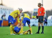 25 June 2008; Josefine Ogvist, Sweden, is helped by team-mate's Lotta Schelin, left, and Victoria Svensson as referee Claudine Brohet looks on. UEFA Women's European Championship Qualifier, Group 2, Republic of Ireland v Sweden, Carlisle Grounds, Bray, Co. Wicklow. Picture credit: Diarmuid Greene / SPORTSFILE