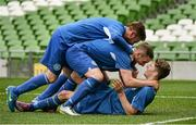 17 May 2015; Greg Moorehouse, right, Crumlin United, celebrates after scoring his side's third goal with team-mates Kevin Dempsey and Alan McGreal. FAI Umbro Intermediate Cup Final, Tolka Rovers v Crumlin United. Aviva Stadium, Lansdowne Road, Dublin. Picture credit: David Maher / SPORTSFILE