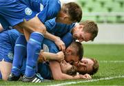 17 May 2015; Greg Moorehouse, bottom front, Crumlin United, celebrates after scoring his side's third goal with team-mates. FAI Umbro Intermediate Cup Final, Tolka Rovers v Crumlin United. Aviva Stadium, Lansdowne Road, Dublin. Picture credit: David Maher / SPORTSFILE