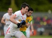 17 May 2015; Mattie Donnelly, Tyrone, in action against Mark McHugh, Donegal. Ulster GAA Football Senior Championship, Preliminary Round, Donegal v Tyrone. MacCumhaill Park, Ballybofey, Co. Donegal. Picture credit: Oliver McVeigh / SPORTSFILE