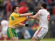 17 May 2015; David Walsh, Donegal, and Justin McMahon, Tyrone, tussle off the ball. Ulster GAA Football Senior Championship, Preliminary Round, Donegal v Tyrone. MacCumhaill Park, Ballybofey, Co. Donegal. Picture credit: Stephen McCarthy / SPORTSFILE