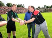 29 June 2008; Down Manager Ross Carr, right, shakes hands with Referee Joe McQuillan before the game. GAA Football Ulster Senior Championship Semi-Final, Down v Armagh, St Tighearnach's Park, Clones, Co. Monaghan. Picture credit: Oliver McVeigh / SPORTSFILE