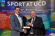 19 May 2015; Alex Murphy, of the UCD Swimming team, collects the Elite Team of the Year Award on behalf of his team, from Prof. Andrew Deeks, President, University College Dublin, at the Bank of Ireland UCD Athletic Union Council Sports Awards 2014/15. UCD, Belfield, Dublin. Picture credit: Brendan Moran / SPORTSFILE
