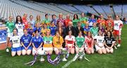 30 June 2008; At the TG4 All-Ireland Ladies Football Championship Launch were, back row, from left, Tara Hughes, Fermanagh, Rebecca Hallahan, Waterford, Angela Walsh, Cork, Denise Masterson, Dublin, Claire O'Hara, Mayo, Grainne Ní Fhlathachta, Mairead Morrisey, Tipperary, Maria Hoey, Galway, Michaela Downey, Down, Marie Devenny, Donegal, Irene Munnelly, Meath, Bernie Deegan, Laois, Aine Kinsella, Carlow, Maeve Moriarity, Armagh, and Gemma Begley, Tyrone. Midlle row, from left, Margaret Kelly, Wexford, Ailson Smith, Longford, Louise Tully, Roscommon, Michelle McElvanely, Longford, Geraldine Giles, Uachtaran Cumann Peil Gael na mBan, Bertie Ahern, T.D., Pól O'Gallchóir, Ceannasai, TG4, Sandra Malone, Clare, Meadhbh Nash, Limerick, Vicki McEnery, Westmeath and Andrea Murphy, Kilkenny. Front row, from left, Niamh Kindlon, Monaghan, Emer Miley, Wicklow, Aisling Doonan, Cavan, Patricia Stapleton, Offaly, Eimear Roantree, representing Antrim, Louise Glass, Derry, Niamh McMullan, representing London, Grace Lynch, Louth, Simone Gilabert, Kildare, and Martina Keane, Sligo. Croke Park, Dublin. Picture credit: Paul Mohan / SPORTSFILE