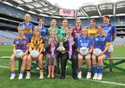 30 June 2008; Players representing counties involved in the TG4 All-Ireland Ladies Intermediate Championship with Geraldine Giles, Uachtaran Cumann Peil Gael na mBan, and Pol O'Gllchoir, Ceannasai, TG4, and the Mary Quinn Memiorial cup, back row, from left, Sandra Malone, Clare, Aisling Doonan, Cavan, Meadhbh Nash, Limerick, Vicki McEnery, representing Westmeath, Louise Tuly, Roscommon and Mairean Morrisey, Tipperary. Front row, from left, Margaret Kelly, Wexford, Andrea Murphy, Kilkenny, Alison Smith and Michelle McElvaney, Longford, at the TG4 All-Ireland Ladies Football Championship Launch, Croke Park, Dublin. Picture credit: Stephen McCarthy / SPORTSFILE