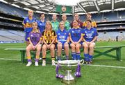 30 June 2008; Players representing counties involved in the TG4 All-Ireland Ladies Intermediate Championship with the Mary Quinn Memiorial cup, back row, from left, Sandra Malone, Clare, Aisling Doonan, Cavan, Meadhbh Nash, Limerick, Vicki McEnery, representing Westmeath, and Louise Tuly, Roscommon. Front row, from left, Margaret Kelly, Wexford, Andrea Murphy, Kilkenny, Alison Smith and Michelle McElvaney, Longford, and Mairean Morrisey, Tipperary, at the TG4 All-Ireland Ladies Football Championship Launch. Croke Park, Dublin. Picture credit: Stephen McCarthy / SPORTSFILE
