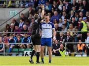 24 May 2015; Referee Padraig Hughes shows Dermot Malone, Monaghan, the black card. Ulster GAA Football Senior Championship Quarter-Final, Cavan v Monaghan. Kingspan Breffni Park, Cavan. Picture credit: David Maher / SPORTSFILE