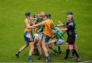 24 May 2015; Donal O'Grady, Limerick, falls to the ground after being struck by Patrick Donnellan, Clare, which resulted in Donnellan receiveing a red card. Munster GAA Hurling Senior Championship Quarter-Final, Clare v Limerick. Semple Stadium, Thurles, Co. Tipperary. Picture credit: Dáire Brennan / SPORTSFILE