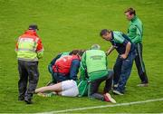 24 May 2015; Limerick manager TJ Ryan checks up on Donal O'Grady, after being struck, which resulted in Patrick Donnellan, Clare, being shown the red card. Munster GAA Hurling Senior Championship Quarter-Final, Clare v Limerick. Semple Stadium, Thurles, Co. Tipperary. Picture credit: Dáire Brennan / SPORTSFILE
