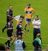 24 May 2015; Clare manager Davy Fitzgerald watches the officials and Clare's Patrick Donnellan leave the field at half time after the Clare player's sending off. Munster GAA Hurling Senior Championship Quarter-Final, Clare v Limerick. Semple Stadium, Thurles, Co. Tipperary. Picture credit: Dáire Brennan / SPORTSFILE