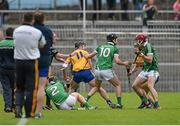 24 May 2015; Clare and Limerick players tussel with each other moments before half time. Referee Colm Lyons issued a red card to Patrick Donnellan shortly after and the Limerick captain Donal O'Grady, 10, was treated for an injury to the face. Munster GAA Hurling Senior Championship Quarter-Final, Clare v Limerick. Semple Stadium, Thurles, Co. Tipperary.  Picture credit: Ray McManus / SPORTSFILE