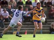 14 May 2000; Martin Daly of Clare in action aganist Laurence Hurney of Waterford during the Bank of Ireland Munster Senior Football Championship Quarter-Final match between Clare and Waterford at Cusack Park in Ennis, Clare. Photo by Ray McManus/Sportsfile