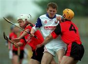 3 June 2000; Kevin Kennedy of New York under pressure from Down players John Caughey, 4, and Gary Gordan, left, during the Guinness Ulster Senior Hurling Championship Quarter-Final match between Down and New York at Casement Park in Belfast, Antrim. Photo by Ray McManus/Sportsfile