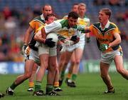 4 June 2000; Sean Grennan of Offaly is tackled by Evan Kelly, left, and Trevor Giles of Meath during the Bank of Ireland Leinster Senior Football Championship Quarter-Final match between Offaly and Meath at Croke Park in Dublin. Photo by Damien Eagers/Sportsfile
