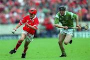 4 June 2000; Sean McGrath of Cork in action against Stephen Lucey of Limerick during the Guinness Munster Senior Hurling Championship Semi-Final match between Cork and Limerick at Semple Stadium in Thurles, Tipperary. Photo by Ray McManus/Sportsfile
